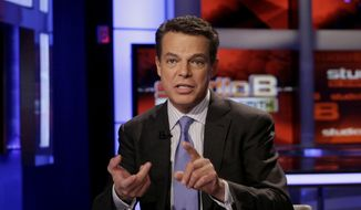 "In this May 24, 2011 file photo, Fox News Channel anchor Shepard Smith broadcasts his ""Studio B"" program, in New York. (AP Photo/Richard Drew, File)"