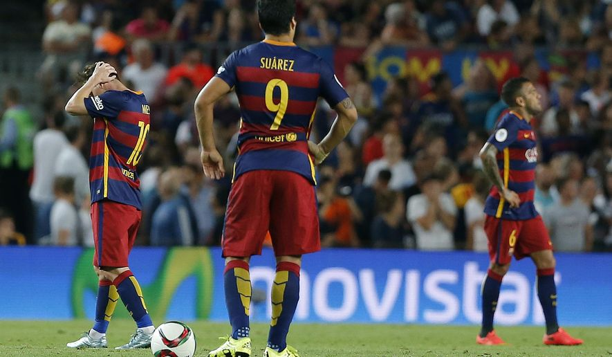Barcelona's Lionel Messi, left, reacts with teammates after Bilbao scored during the second leg Spanish Super Cup soccer match between FC Barcelona and Athletic Bilbao at the Camp Nou stadium in Barcelona, Spain, Monday, Aug.17, 2015. (AP Photo/Emilio Morenatti)