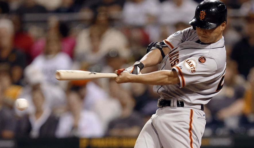 San Francisco Giants' Nori Aoki gets a base hit to lead off the ninth inning of a baseball game against the Pittsburgh Pirates, Thursday, Aug. 20, 2015, in Pittsburgh. The Pirates won 4-0. (AP Photo/Keith Srakocic)