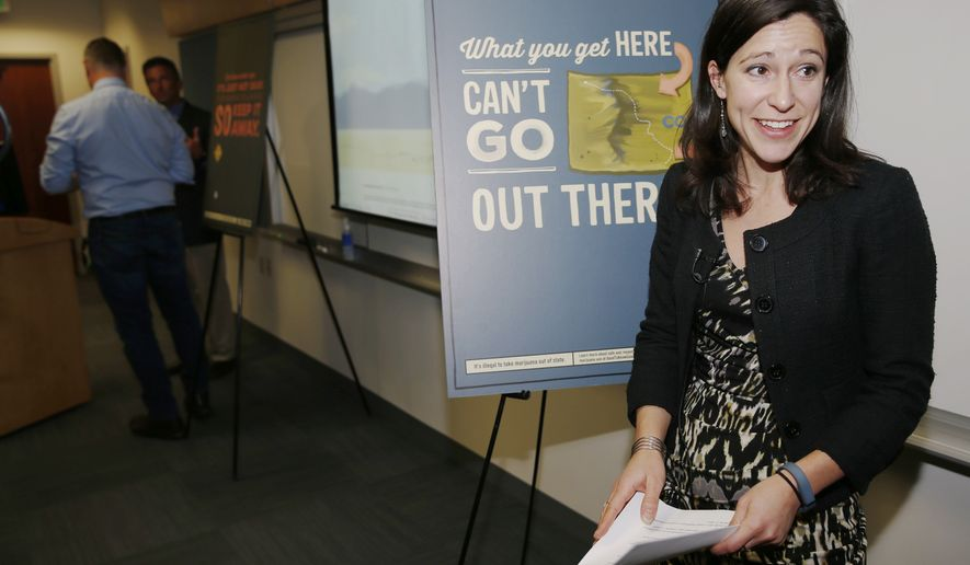 "In this Jan. 5, 2015 file photo, Ali Maffey, retail marijuana education manager for the Colorado Department of Health and Environment, talks to reporters after a news conference to announce the rollout of the $5.7-million, state-sponsored advertising campaign to educate marijuana consumers in Denver. The ""Good to Know"" advertisements will focus on marijuana laws and health effects, including the ban on use in public places, age restrictions, DUI laws, the dangers of overuse and other concerns related to the use of the products. A legislative bill is facing its first hearing on Tuesday, Feb. 3, that proposes pot shops post signs warning of the risks that maternal marijuana use poses to unborn children. (AP Photo/David Zalubowski/File)"