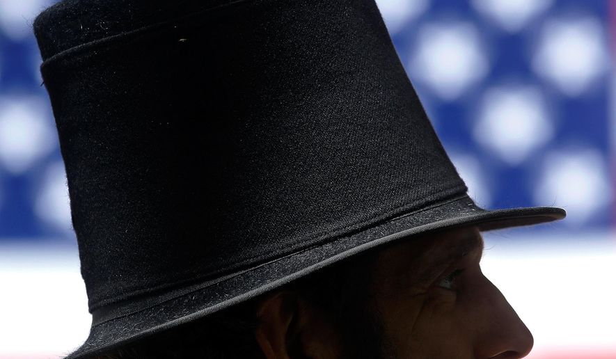 Abraham Lincoln presenter, Randy Duncan from Carlinville, Ill., participates in the Democrats Day rally at the Illinois State Fair on Thursday, Aug. 20, 2015, in Springfield, Ill. (AP Photo/Seth Perlman)