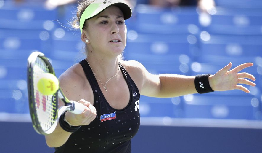 Belinda Bencic, of Switzerland, returns the ball to  Lucie Safarova, of the Czech Republic, during a match at the Western & Southern Open tennis tournament, Thursday, Aug. 20, 2015, in Mason, Ohio. (AP Photo/John Minchillo)""