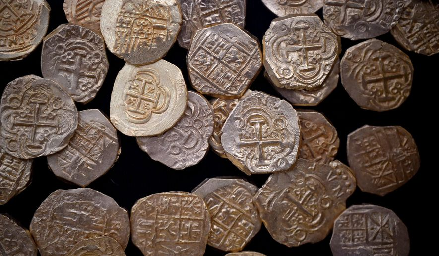 Some of the gold coins valued at $4.5-million found off the coast of Wabasso Beach on July 30-31, 2015 are on display during a news conference Thursday, Aug. 20, 2015 in Sebastian, Fla. The crew of the Capitana from 1715 Fleet - Queens Jewels LLC, discussed their discovery of more than 350 gold coins valued at $4.5-million found on July 30-31, 2015 off the coast of Wabasso Beach. (Eric Hasert/The Stuart News via AP) FLORIDA TODAY OUT; MAGS OUT; MANDATORY CREDIT