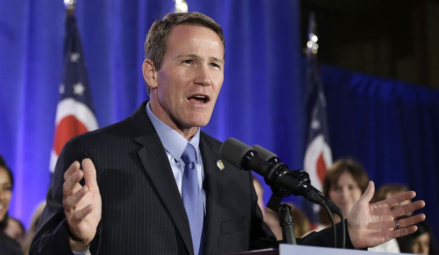 FILE - In this Nov. 4, 2014,  file photo, Ohio Secretary of State Jon Husted speaks to supporters at the Ohio Republican Party election night celebration in Columbus, Ohio. Residents in three Ohio counties contend in a lawsuit that the Secretary of State violated their rights when he invalidated ballot proposals they offered that would have restricted development projects related to the gas-drilling technique known as fracking. (AP Photo/Tony Dejak, File)