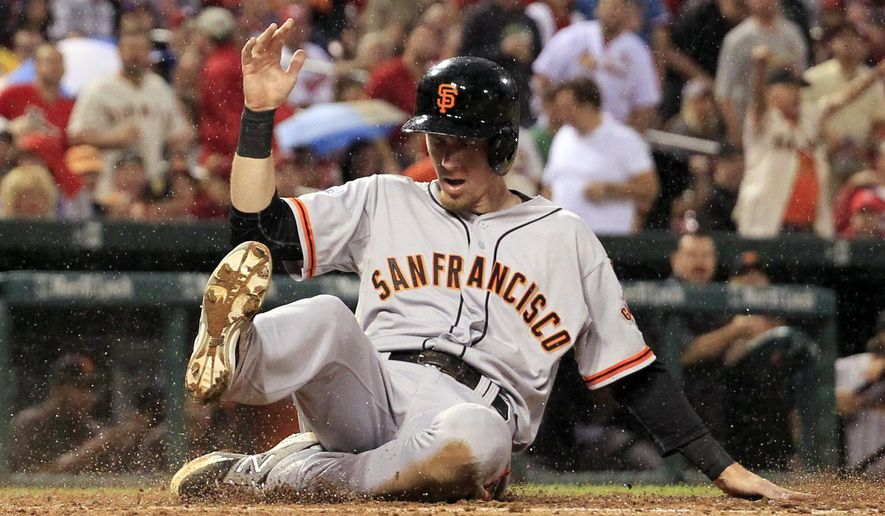 San Francisco Giants' Matt Duffy scores during the sixth inning of a baseball game against the St. Louis Cardinals, Wednesday, Aug. 19, 2015, in St. Louis. (AP Photo/Jeff Roberson)