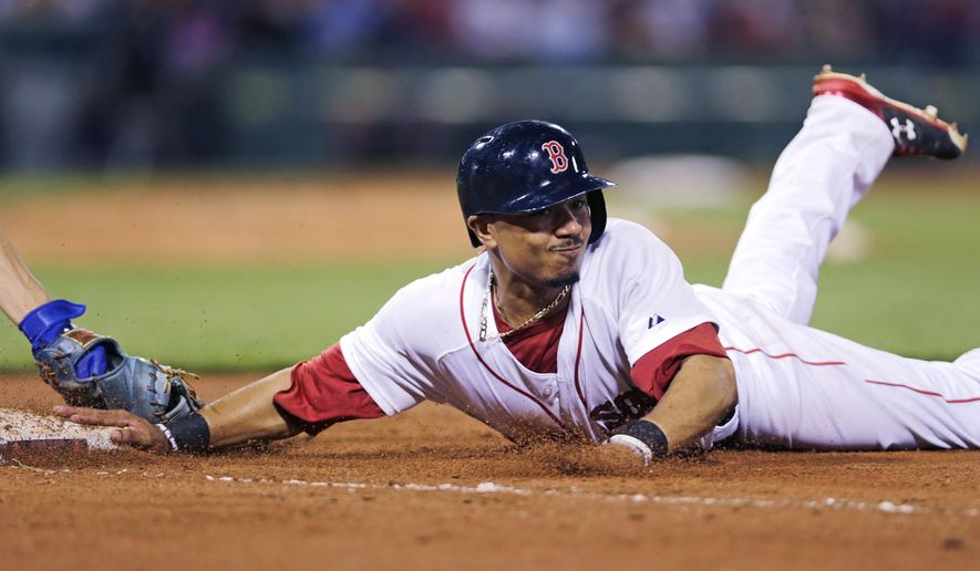 Boston Red Sox's Mookie Betts dives back safely under the tag of Kansas City Royals first baseman Eric Hosmer on a pick-off attempt during the seventh inning of a baseball game at Fenway Park in Boston, Thursday, Aug. 20, 2015. (AP Photo/Charles Krupa)