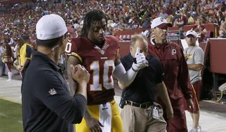 Washington Redskins quarterback Robert Griffin III (10) leaves the field after an injury during the first half of an NFL preseason football game against the Detroit Lions, Thursday, Aug. 20, 2015, in Landover, Md. (AP Photo/Alex Brandon)
