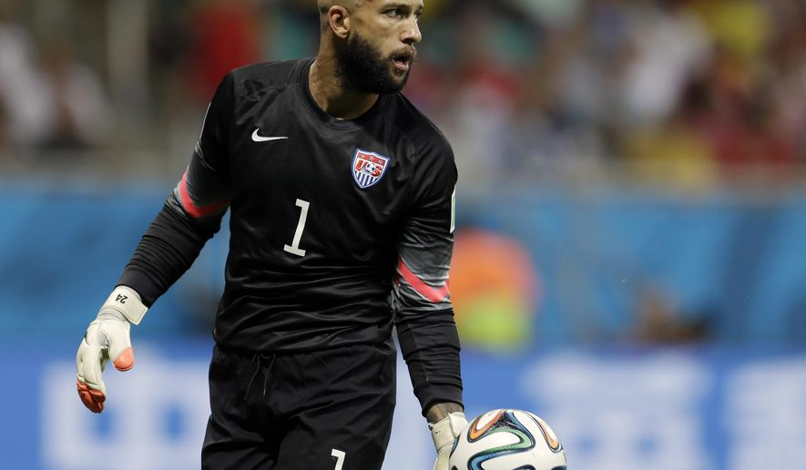 FILE - In this July 1, 2014, file photo, United States' goalkeeper Tim Howard gets ready to kick the ball during the World Cup round of 16 soccer match between Belgium and the USA at the Arena Fonte Nova in Salvador, Brazil. Goalkeeper Tim Howard is back with the U.S. national team. The U.S. Soccer Federation announced Thursday, Aug. 20, 2015, that coach Jurgen Klinsmann had called up Howard and veteran defender DaMarcus Beasley for exhibitions next month against Peru and Brazil. (AP Photo/Natacha Pisarenko, File)