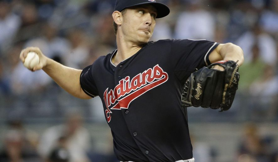 Cleveland Indians' Josh Tomlin winds up during the first inning of a baseball game against the New York Yankees on Thursday, Aug. 20, 2015, in New York. (AP Photo/Frank Franklin II)