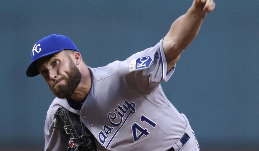 Kansas City Royals starting pitcher Danny Duffy delivers against the Boston Red Sox during the first inning of a baseball game at Fenway Park in Boston, Thursday, Aug. 20, 2015. (AP Photo/Charles Krupa)