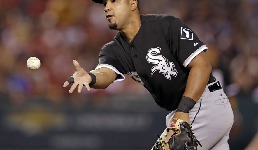 Chicago White Sox first baseman Jose Abreu throws Los Angeles Angels' Kole Calhoun out at first during the fifth inning of a baseball game in Anaheim, Calif., Wednesday, Aug. 19, 2015. (AP Photo/Chris Carlson)