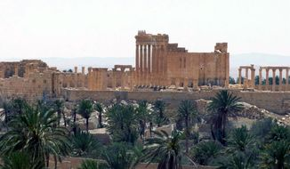 This file photo released on Sunday, May 17, 2015, by the Syrian official news agency SANA, shows the general view of the ancient Roman city of Palmyra, northeast of Damascus, Syria. The rampage by the Islamic State, targeting priceless cultural artifacts often spanning thousands of years, has sparked global outrage and accusations of war crimes. (SANA via AP, File)