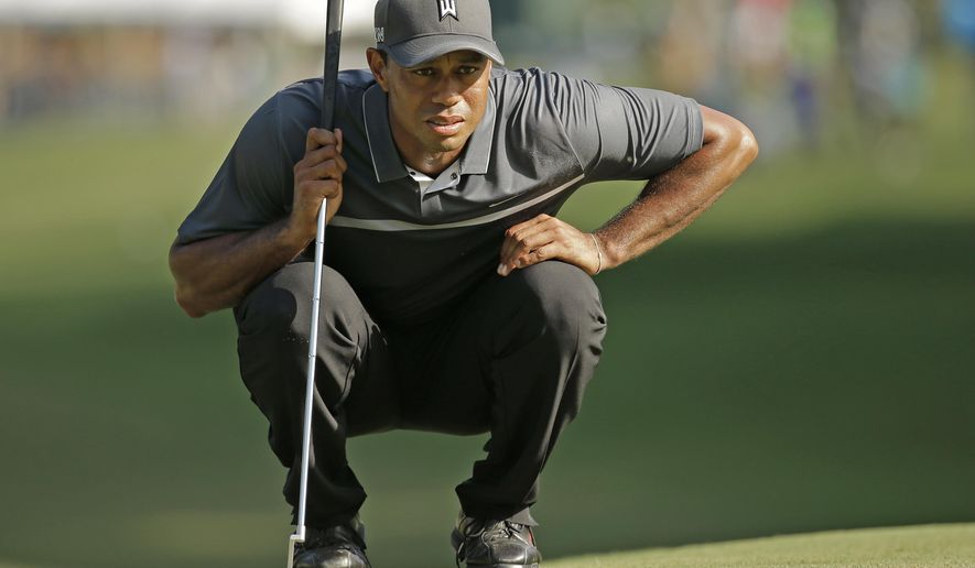 Tiger Woods lines up a putt on the 17th hole during the second round of the Wyndham Championship golf tournament in Greensboro, N.C., Friday, Aug. 21, 2015. (AP Photo/Chuck Burton)
