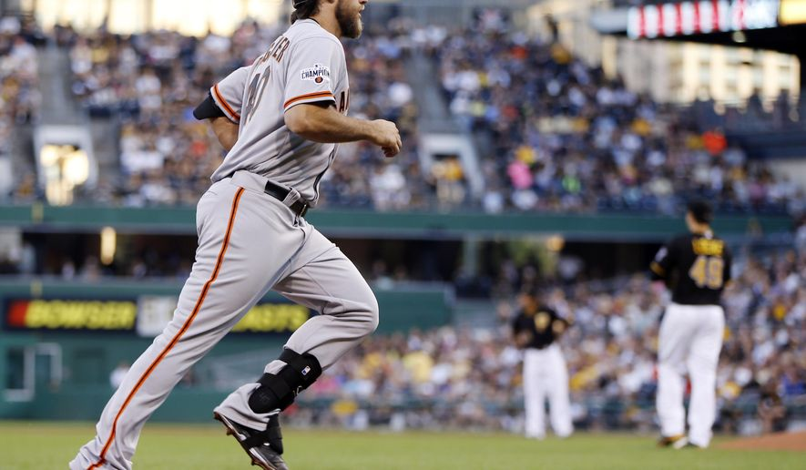 San Francisco Giants starting pitcher Madison Bumgarner, left, rounds the bases after hitting a two-run home run off Pittsburgh Pirates starting pitcher Jeff Locke, right, in the second inning of a baseball game, Friday, Aug. 21, 2015, in Pittsburgh. (AP Photo/Keith Srakocic)