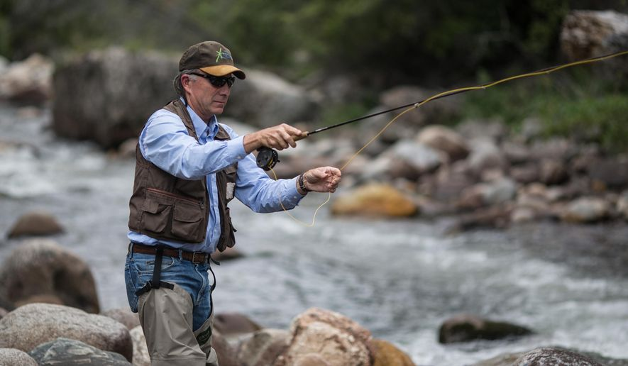 In this photo taken July 27, 2015, Tom Annear, water management supervisor for Wyoming Game and Fish Department, fishes Ten Sleep Creek east of of Ten Sleep, Wyo. The state owns instream flow water rights to 22 cubic feet per second along a 7.9-mile stretch of the creek, which was the fourth creek filed for instream flow rights after Annear began his career in Wyoming in 1981. (Ryan Dorgan/The Casper Star-Tribune via AP) MANDATORY CREDIT