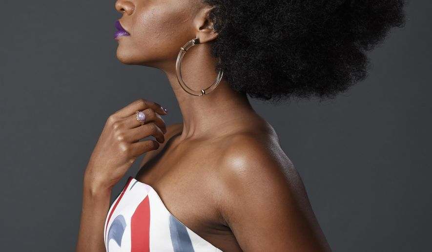 """FILE - In this July 31, 2015 file photo, Teyonah Parris, a cast member in the television series """"Survivor's Remorse,"""" poses for a portrait during the 2015 Television Critics Association Summer Press Tour in Beverly Hills, Calif. """"Survivor's Remorse"""" returns for a second season on Saturday, Aug. 22 on Starz. (Photo by Chris Pizzello/Invision/AP, File)"""