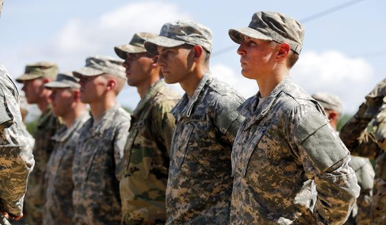 U.S. Army 1st Lt. Shaye Haver, right, stands in formation during an Army Ranger school graduation ceremony Friday, Aug. 21, 2015, at Fort Benning, Ga. Lt. Haver and Capt. Kristen Griest became the first female soldiers to complete the Army's rigorous school, putting a spotlight on the debate over women in combat. (AP Photo/John Bazemore)
