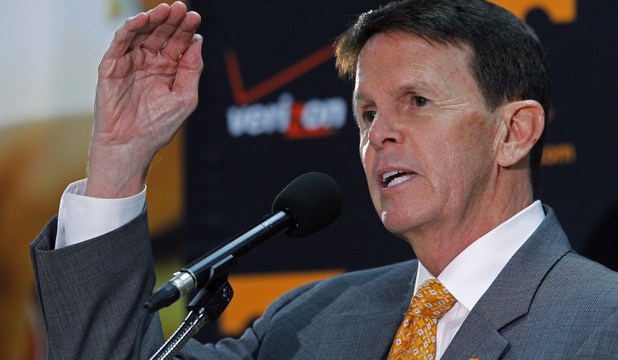 FILE - In this March 27, 2015, file photo, University of Tennessee athletic director Dave Hart gestures as he speaks to reporters about the firing of head basketball coach Donnie Tyndall, in Knoxville, Tenn. Hart is ready to look ahead to 2015-16 after a tumultuous year that included record fundraising and modest improvements on the field but also the abrupt firing of men's basketball coach Donnie Tyndall and criticism over the elimination of the Lady Vols nickname in all sports but basketball. (AP Photo/Wade Payne, File)