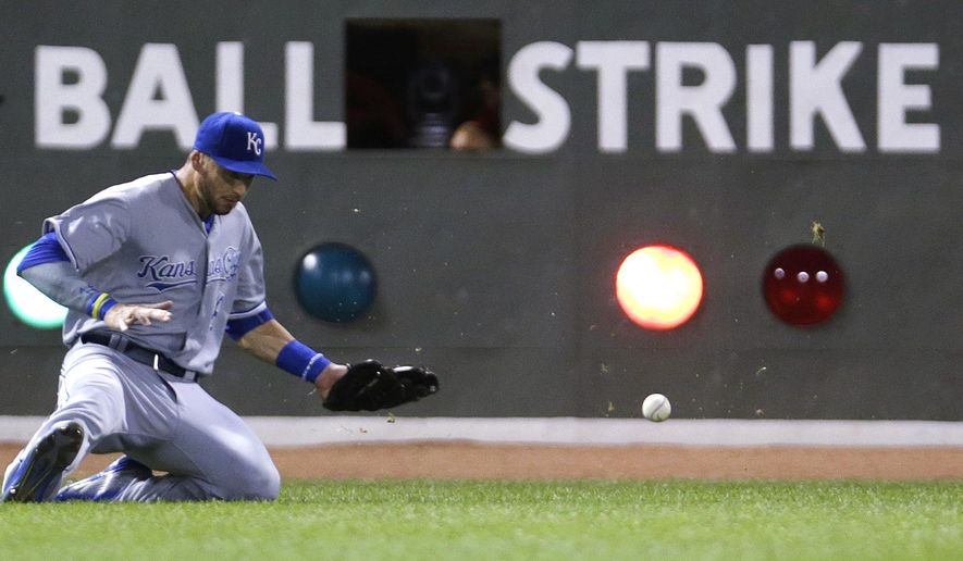 Kansas City Royals left fielder Paulo Orlando (16) can't get a glove on a two RBI double by Boston Red Sox's Blake Swihart during the second inning of a baseball game at Fenway Park in Boston, Friday, Aug. 21, 2015. (AP Photo/Charles Krupa)