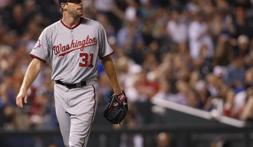 Washington Nationals starting pitcher Max Scherzer reacts after giving up an RBI-single to Colorado Rockies' Yohan Flande in the sixth inning of a baseball game Thursday, Aug. 20, 2015, in Denver. Colorado won 3-2. (AP Photo/David Zalubowski)