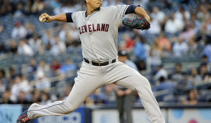 Cleveland Indians pitcher Carlos Carrasco delivers against the New York Yankees during the first inning of a baseball game, Friday, Aug. 21, 2015, in New York. (AP Photo/Julie Jacobson)