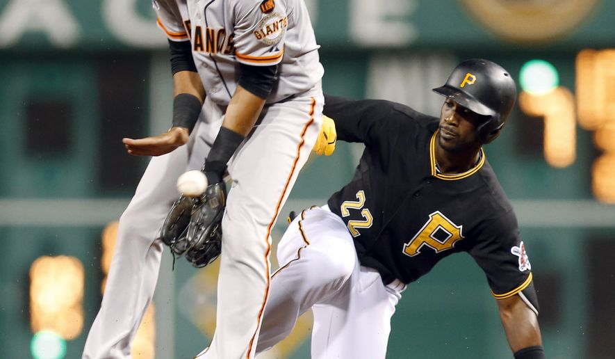 Pittsburgh Pirates' Andrew McCutchen, right, gets to second with a double as San Francisco Giants second baseman Ehire Adrianza tries to control the ball in the eighth inning of a baseball game, Friday, Aug. 21, 2015, in Pittsburgh. The Giants won 6-4. (AP Photo/Keith Srakocic)