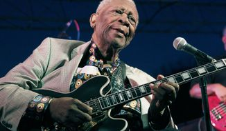 FILE - In this Aug. 22, 2012 file photo, B.B. King performs at the 32nd annual B.B. King Homecoming in Indianola, Miss. A judge in Las Vegas is due to hear a bid by some of B.B. King's heirs to obtain the late blues icon's medical records. A lawyer for King's estate, Brent Bryson, has called the scheduled Friday, Aug. 21, 2015, probate hearing a needless effort by disgruntled family members to raise questions about the care King received before he died May 14. (AP Photo/Rogelio V. Solis, File)