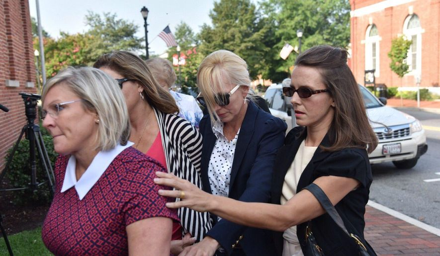 Molly Shattuck, second from right, arrives at the Sussex County Courthouse in Georgetown, Del., for sentencing, Friday, Aug. 21, 2015. Former Baltimore Ravens cheerleader Molly Shattuck has been sentenced to two years of probation after pleading guilty to raping a 15-year-old boy at a vacation rental home in Delaware. The 48-year-old collapsed to her knees after she was sentenced Friday morning and wept as she apologized.  (Kim Hairston/The Baltimore Sun via AP)  WASHINGTON EXAMINER OUT; MANDATORY CREDIT