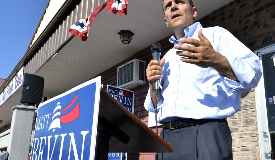 Kentucky Republican Gubernatorial candidate Matt Bevin addresses his supporters from the steps of his campaign headquarters in Somerset Ky., Friday, Aug. 21, 2015. (AP Photo/Timothy D. Easley)