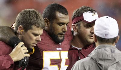 Washington Redskins inside linebacker Adam Hayward (55) leaves the field with an injury during the first half of an NFL preseason football game against the Detroit Lions in Landover, Md., Thursday, Aug. 20, 2015. (AP Photo/Mark Tenally)