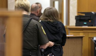 One of the two girls accused of stabbing a classmate leaves a Waukesha County court room in Waukesha, Wis., Monday, Aug. 10, 2015. The judge ruled that the two girls will stay in adult court, where they could face decades in prison. (Mike De Sisti/Milwaukee Journal Sentinel via AP, Pool)