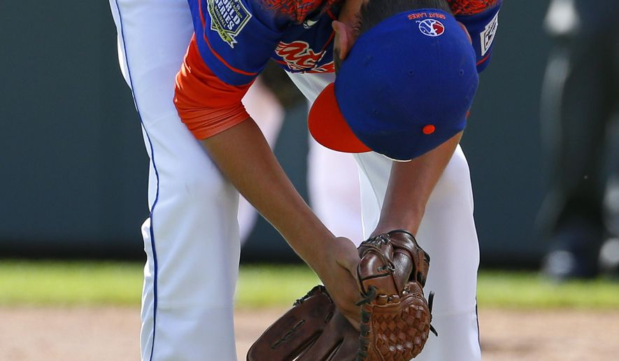Bowling Green, Kentucky pitcher Ty Bryant  reacts to giving up a grand slam to Bonita, California's Nick Maldonado during the third inning of a baseball game in United States pool play at the Little League World Series tournament in South Williamsport, Pa., Friday, Aug. 21, 2015. The West won 14-2. (AP Photo/Gene J. Puskar)