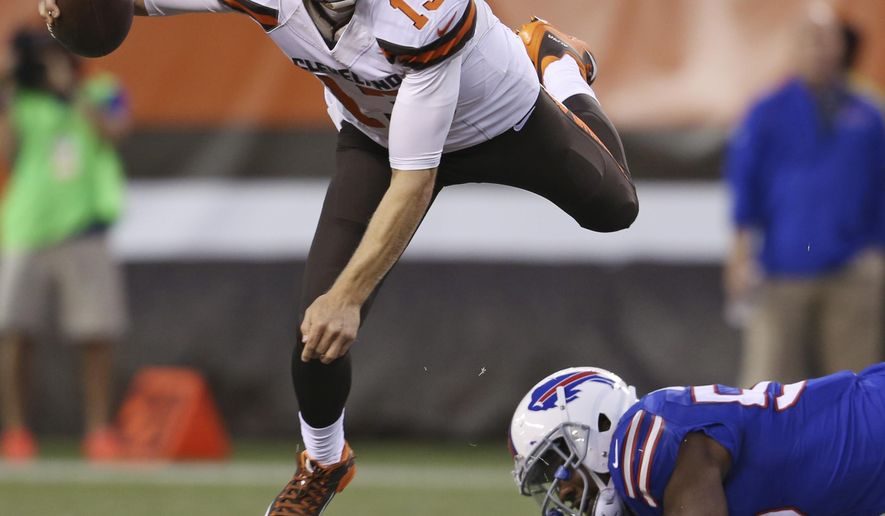 Cleveland Browns quarterback Josh McCown (13) is sacked by Buffalo Bills defensive end Jerry Hughes during the first quarter of an NFL preseason football game, Thursday, Aug. 20, 2015, in Cleveland. (AP Photo/Ron Schwane)