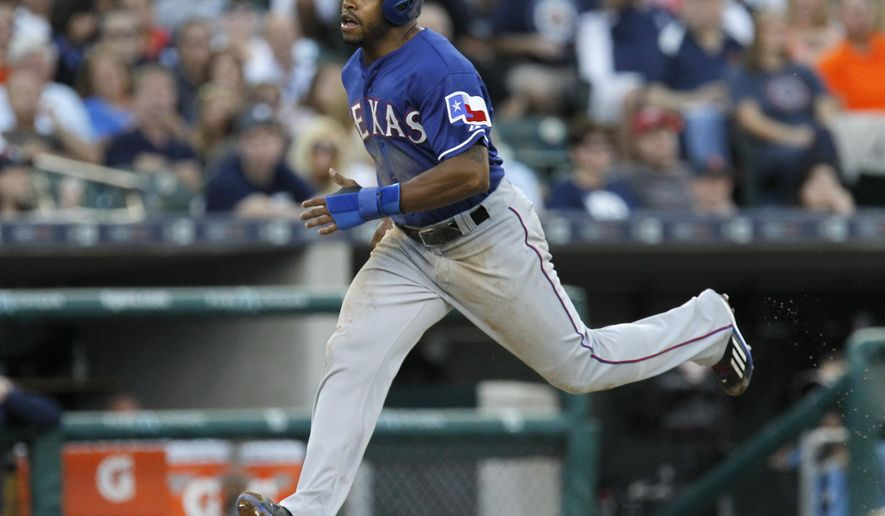 Texas Rangers' Delino DeShields scores from third base on a sacrifice fly by Prince Fielder during the third inning of a baseball game against the Detroit Tigers on Friday, Aug. 21, 2015, in Detroit. (AP Photo/Duane Burleson)