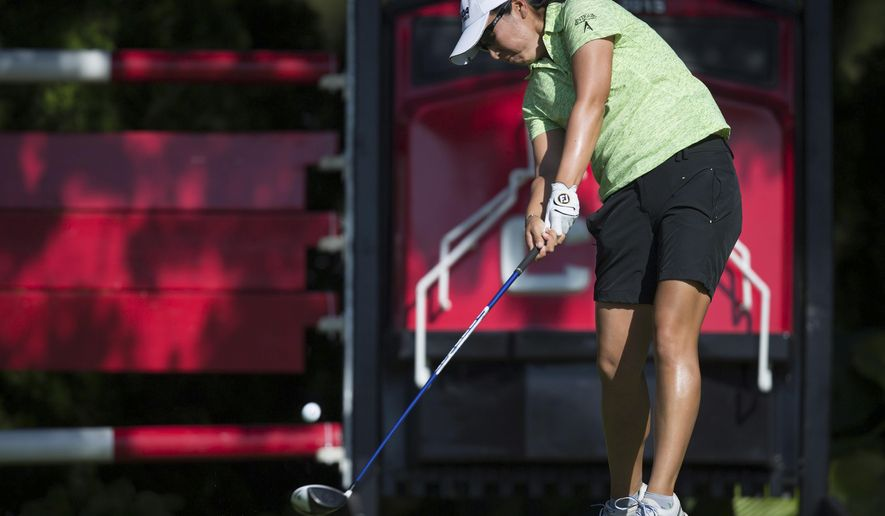 Candie Kung, of the United States, tees off on the first hole during the second round of the Canadian Pacific Women's Open golf tournament, Friday, Aug. 21, 2015, in Coquitlam, British Columbia. (Darryl Dyck/The Canadian Press via AP)