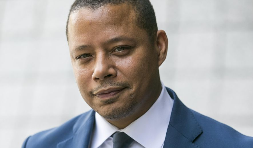 FILE - In this Thursday, Aug. 13, 2015 file photo, actor Terrence Howard walks into a Los Angeles court for a hearing on a divorce settlement with his ex-wife Michelle Ghent, in Los Angeles. Howard spent four days at the hearing, recounting threats he claims Ghent made to leak private information about him, and facing questions about arrests and accusations of violence dating back 15 years. A judge is scheduled to rule on Monday, Aug. 24, 2015, on whether the Oscar-nominated actor can overturn the divorce settlement that entitles Ghent to a portion of his earnings. (AP Photo/Damian Dovarganes, File)