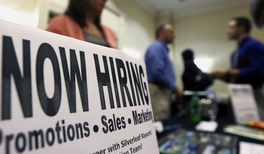 A sign attracts job-seekers during a job fair at the Marriott Hotel in Colonie, N.Y., in this Oct. 25, 2012, file photo. (AP Photo/Mike Groll, File)