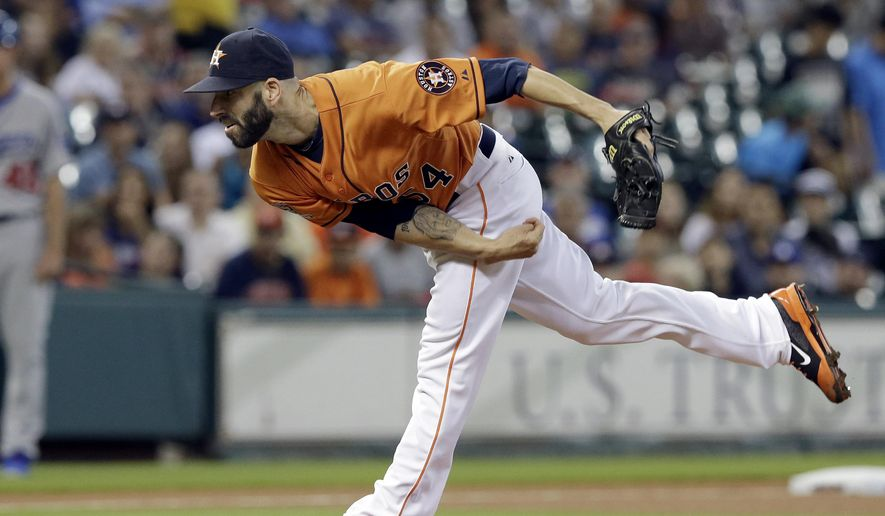 Houston Astros' Mike Fiers follows through on a pitch against the Los Angeles Dodgers during the first inning of a baseball game Friday, Aug. 21, 2015, in Houston. (AP Photo/Pat Sullivan)