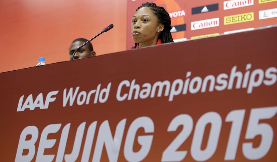 United States' Allyson Felix responds to a question during a news conference before the upcoming World Athletic Championships at the Bird's Nest stadium in Beijing, Friday, Aug. 21, 2015. (AP Photo/Lee Jin-man)