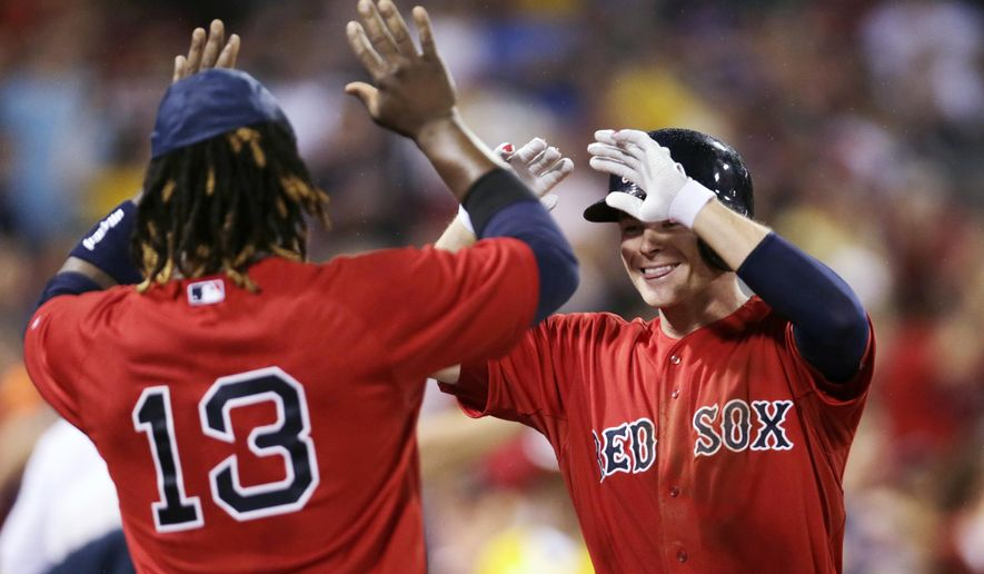 Boston Red Sox's Josh Rutledge, right, is congratulated by Hanley Ramirez after his two-run home run against the Kansas City Royals during the sixth inning of a baseball game at Fenway Park in Boston, Friday, Aug. 21, 2015. (AP Photo/Charles Krupa)