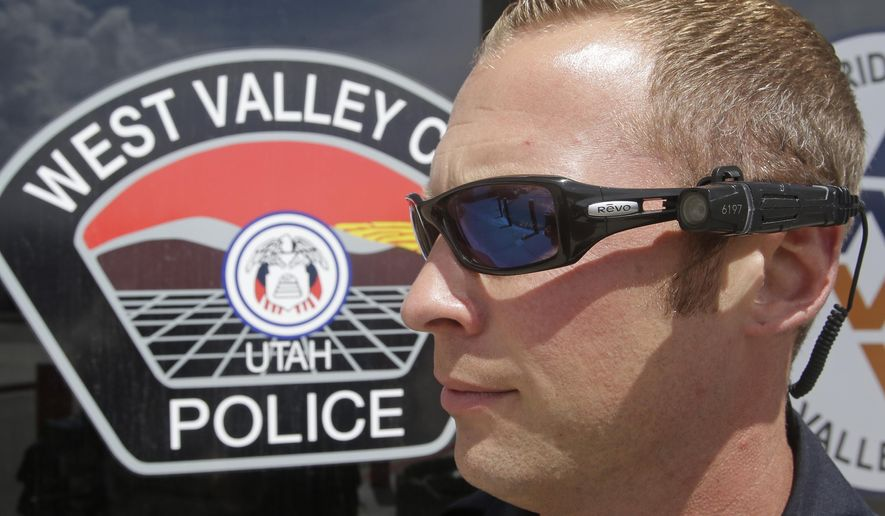 FILE - In this May 11, 2015 file photo, Sgt. Mike Fossmo, of the West Valley City Police, wears a video camera on his eyeglasses during a demonstration, in West Valley City, Utah. Utah lawmakers looking to regulate police use of body cameras are working on competing proposals that would either set specific rules about when to wear cameras and how long to keep video or simply allow police to set their own rules. (AP Photo/Rick Bowmer, File)