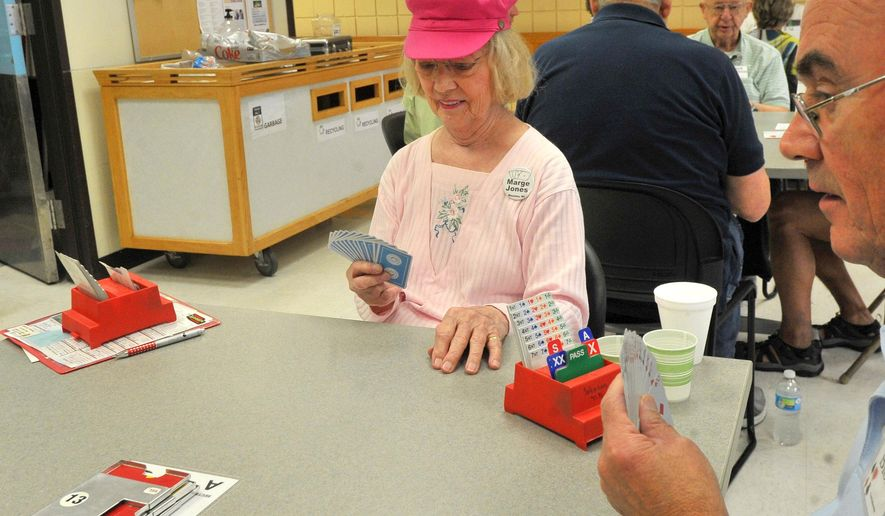 ADVANCE FOR THE WEEKEND OF AUG. 22-24 AND THEREAFTER - In an Aug. 11, 2015 photo, Marge Jones plays bridge, at the Aging and Disabilities Resource Center in Wausau, Wis. After 50 years of playing bridge, Jones has become one of the card game's most accomplished players: a Gold Life Master. For her, the rank represents the time, passion and study she has devoted to the game since she first started to learn in the mid-1960s. (T'xer Zhon Kha/Wausau Daily Herald via AP)