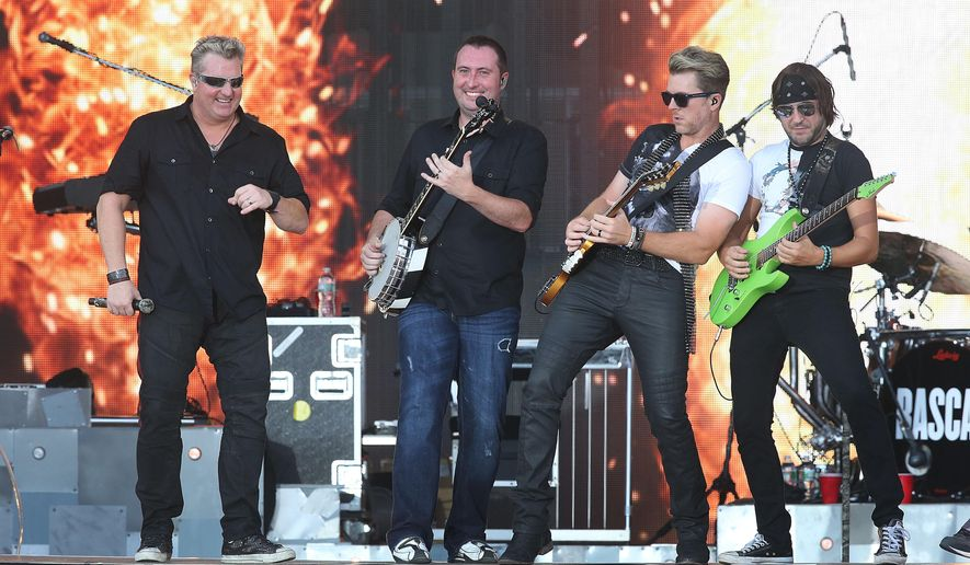 CORRECTS BYLINE TO BEN FOGLETTO NOT VERNON OGRODNEK Rascal Flatts performs during a beach concert in Atlantic City, NJ, Thursday, Aug. 20, 2015. (Ben Fogletto/The Press of Atlantic City via AP)
