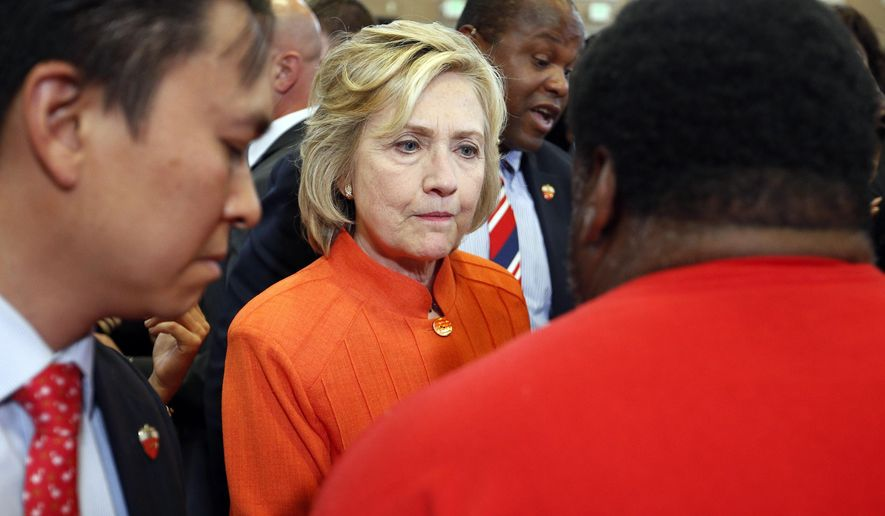 In this Aug. 18, 2015, photo, Democratic presidential candidate Hillary Rodham Clinton speaks with people at a town hall meeting in North Las Vegas, Nev. Clinton's campaign is facing fresh worries among congressional Democrats about her use of a private email account while serving as secretary of state. Poll results suggest the inquiry may be taking a toll on her presidential campaign. (AP Photo/John Locher)