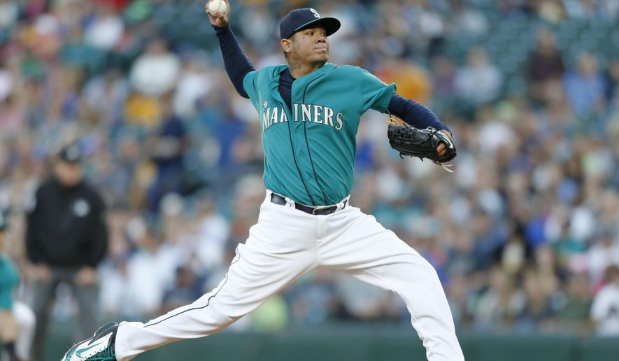 Seattle Mariners' Felix Hernandez pitches against the Chicago White Sox during the first inning of a baseball game Friday, Aug. 21, 2015, in Seattle. (AP Photo/John Froschauer)