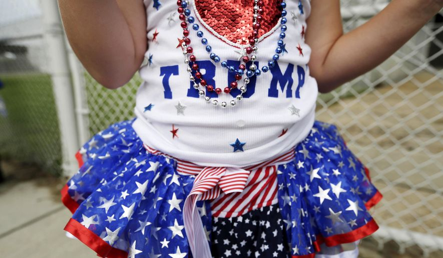 Laci Lamb, 6, of Lucedale, Miss., wears a beauty pageant dress her mother made for her before Republican presidential candidate and businessman Donald Trump speaks at a campaign pep rally, Friday, Aug. 21, 2015, in Mobile, Ala. (AP Photo/Brynn Anderson)