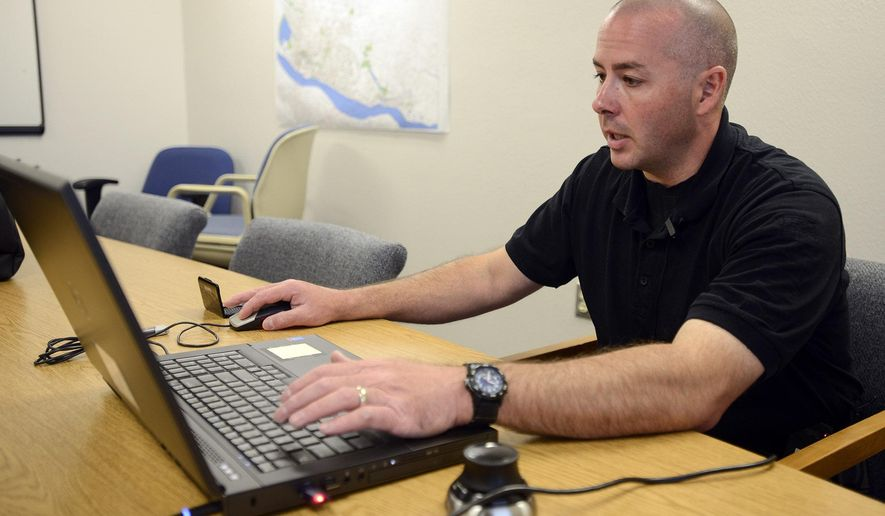 This photo taken Aug. 5, 2015, shows detective Joe Swensen, a crime scene detective with the Clark County Sheriff's Office Major Crimes Unit, looking through footage from a 3-D laser scanner, which is being used to capture crime scenes in Clark County, Wash. Swenson said the piece of equipment makes crime investigations more accurate. (Ariane Kunze/The Columbian via AP)
