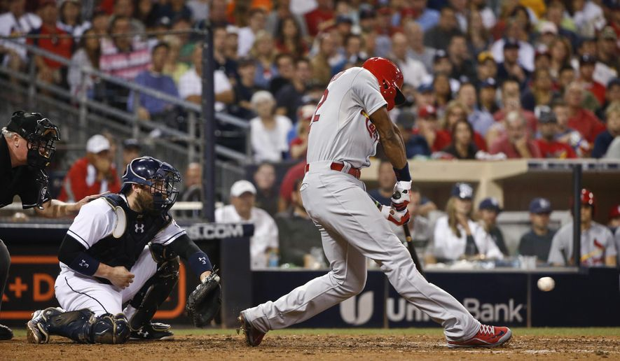 St. Louis Cardinals' Jason Heyward strikes out against the San Diego Padres with two runners on base to end the top of the seventh inning of a baseball game Friday, Aug. 21, 2015, in San Diego. (AP Photo/Lenny Ignelzi)