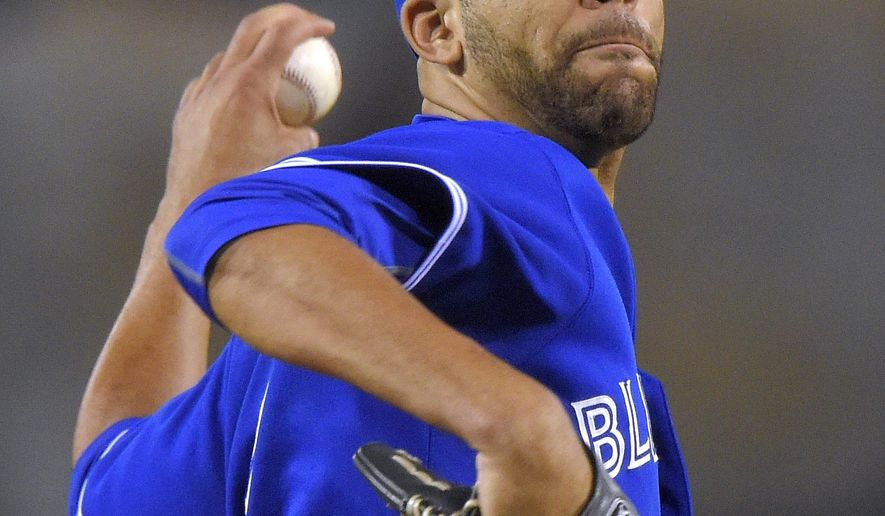 Toronto Blue Jays starting pitcher David Price throws to the plate during the first inning of a baseball game against the Los Angeles Angels, Friday, Aug. 21, 2015, in Anaheim, Calif. (AP Photo/Mark J. Terrill)
