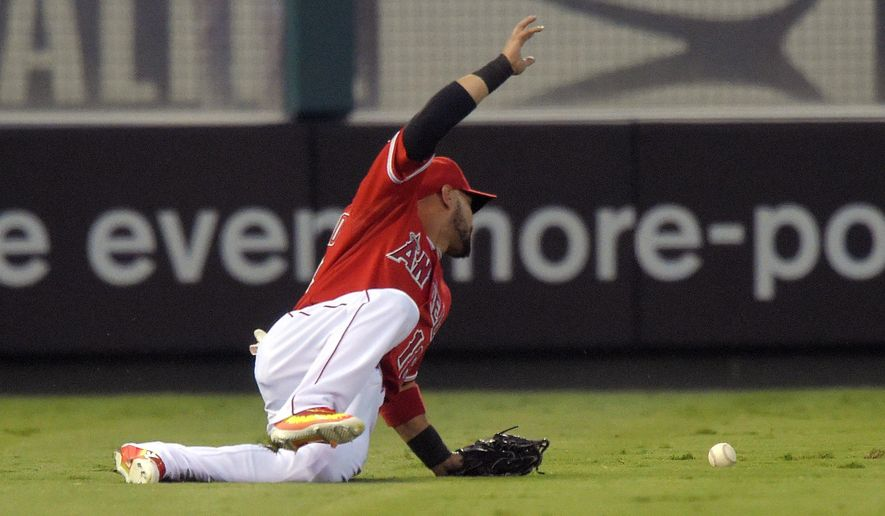 Los Angeles Angels left fielder Shane Victorino is unable to catch a ball hit by Toronto Blue Jays' Kevin Pillar during the first inning of a baseball game, Friday, Aug. 21, 2015, in Anaheim, Calif. Two runs scored on the play. (AP Photo/Mark J. Terrill)